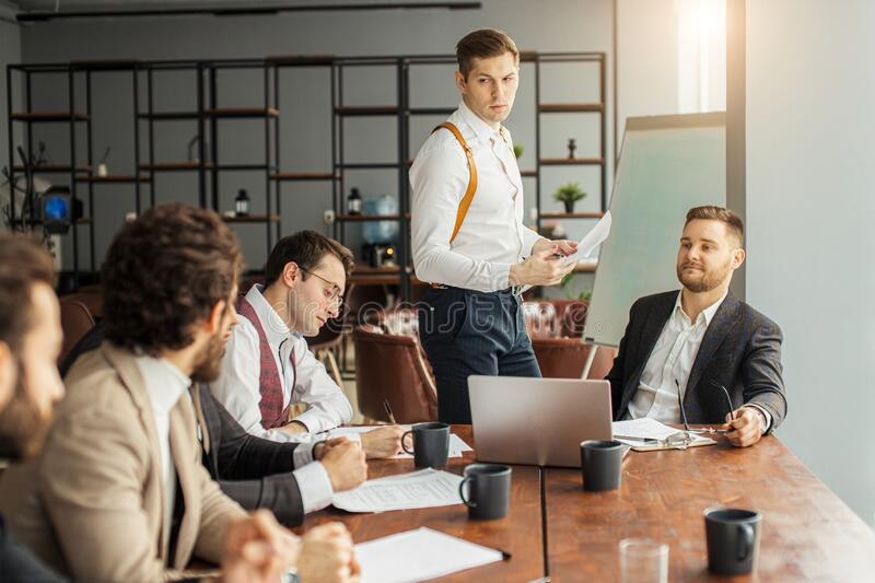 Business people hold conference at office stock images