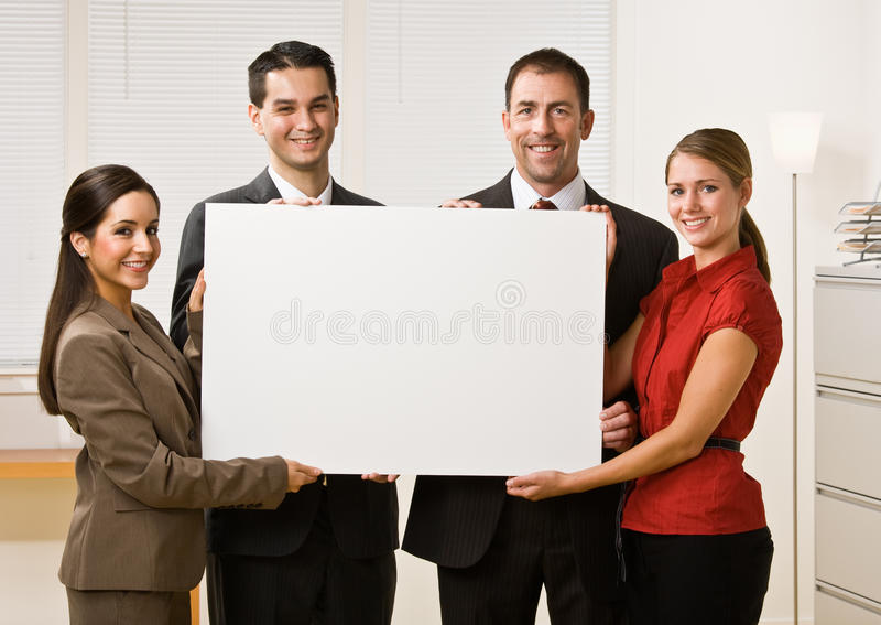 Business people holding blank paper. Business people holding up a blank card royalty free stock image