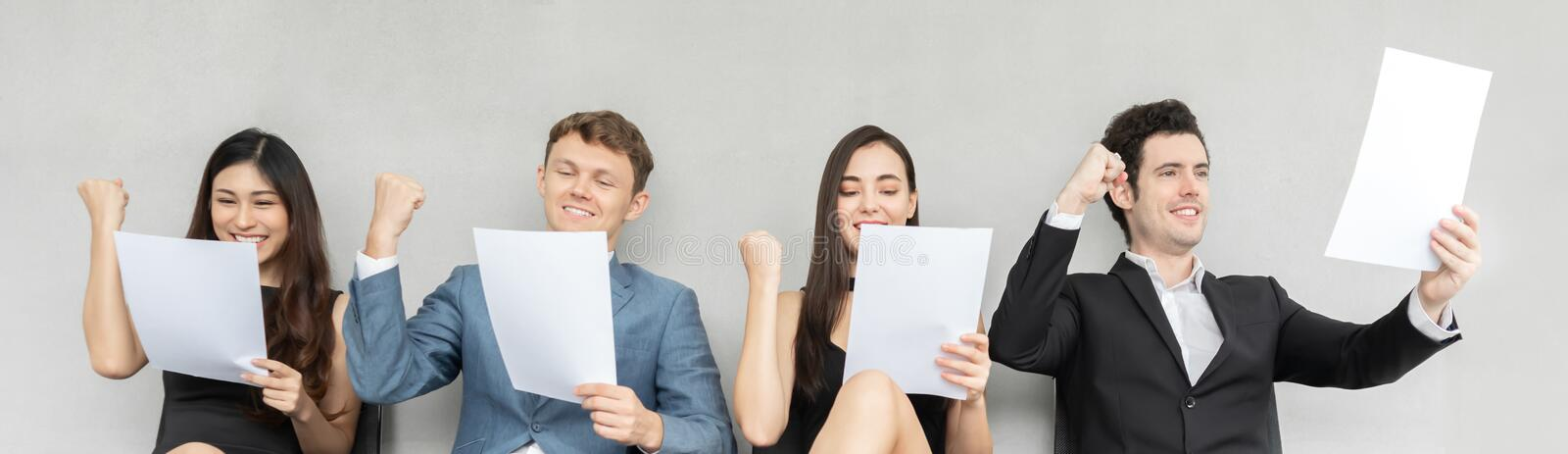 Business people holding and looking at the paper stock photography