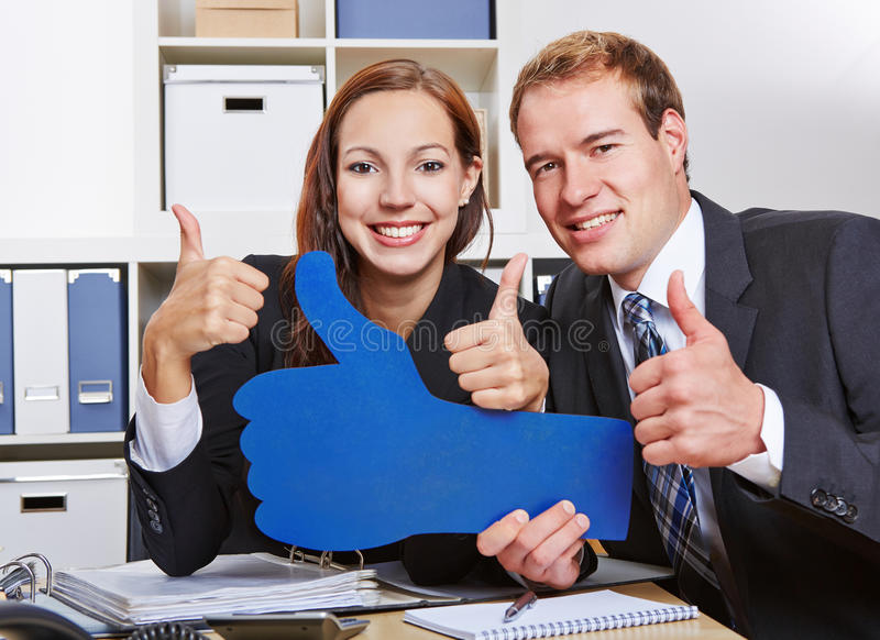 Business people holding many thumbs stock photos