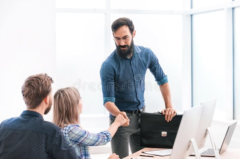 Business people holding out their hands for a handshake stock photo