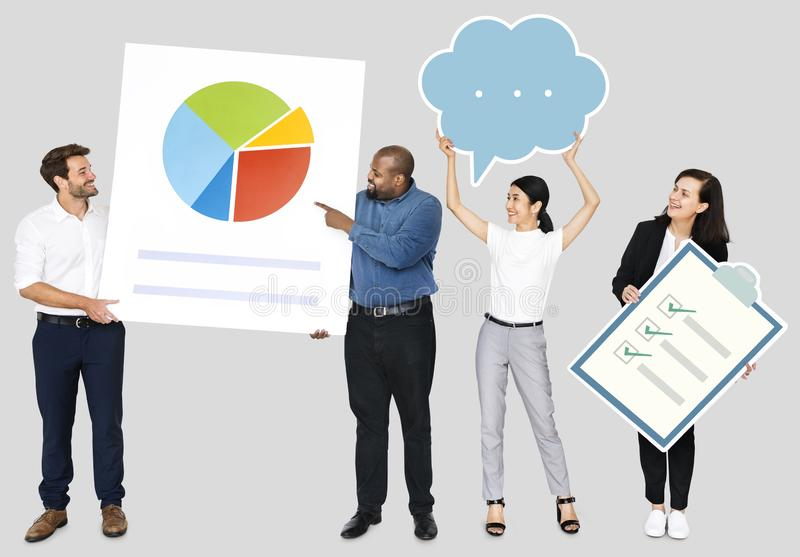 Business people holding a pie chart and a checklist stock photo
