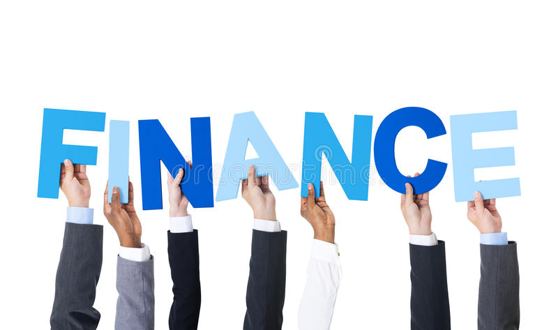 Business People Holding the Word Finance royalty free stock image