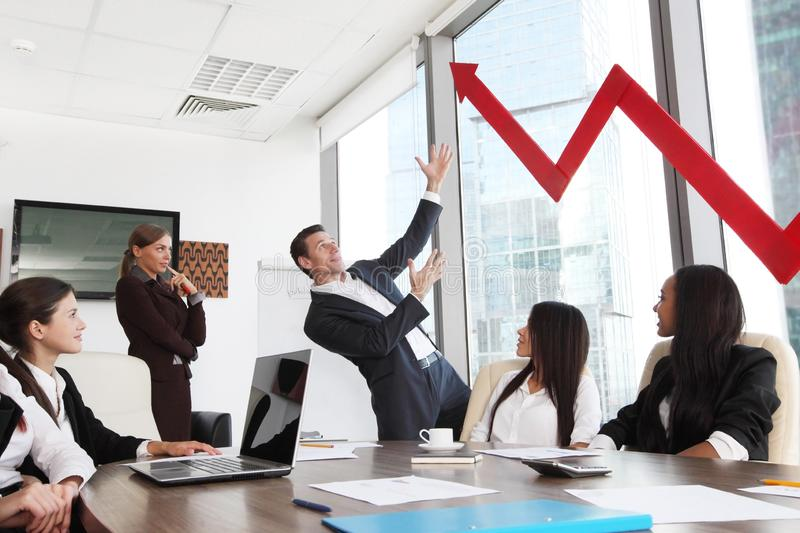 Business people and income growth. Business people discuss red arrow of income growth at meeting stock photos