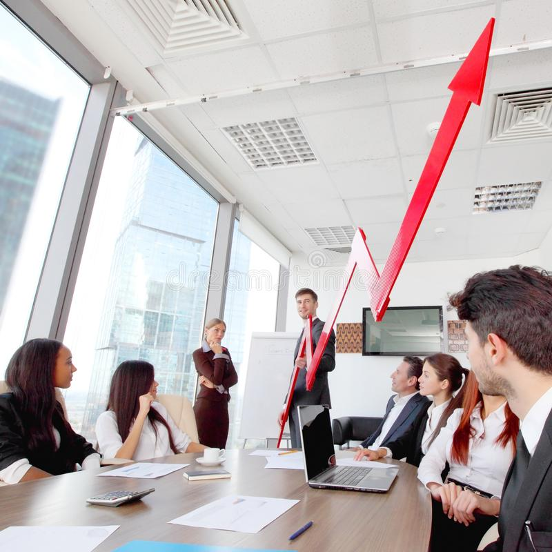 Business people and income growth. Business people discuss red arrow of income growth at meeting stock images
