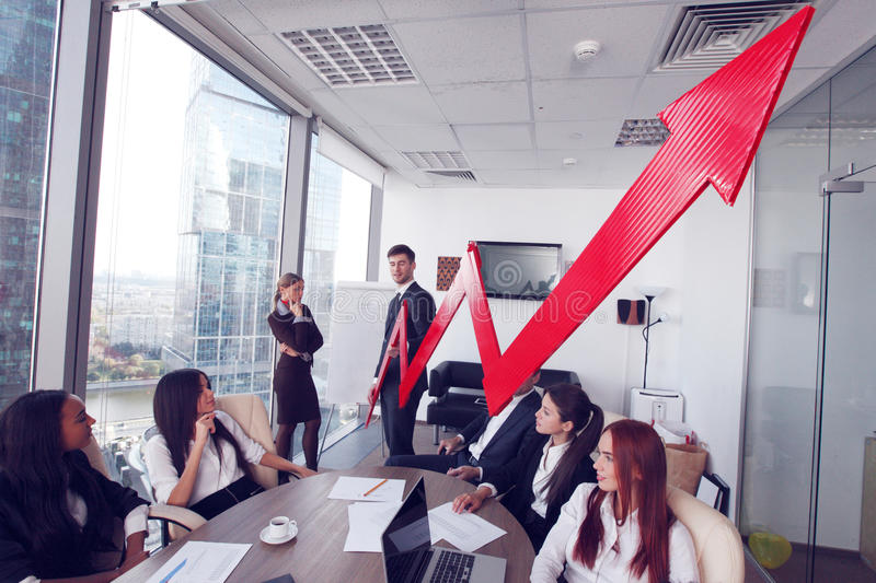 Business people and income growth. Business people discuss red arrow of income growth at meeting stock image
