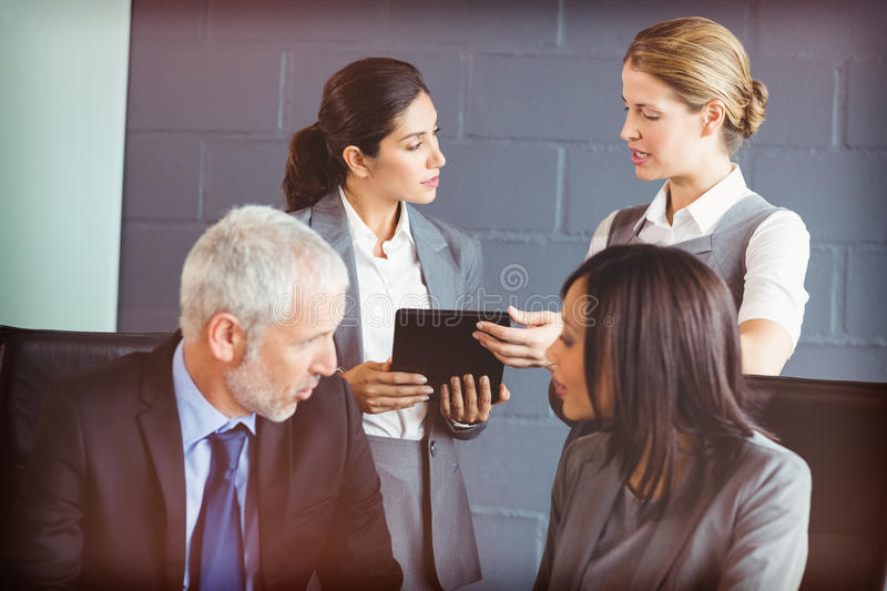 Business people interacting in conference room stock photos