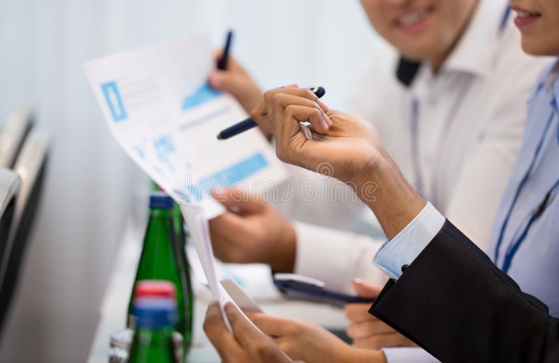 Business people at international conference stock images