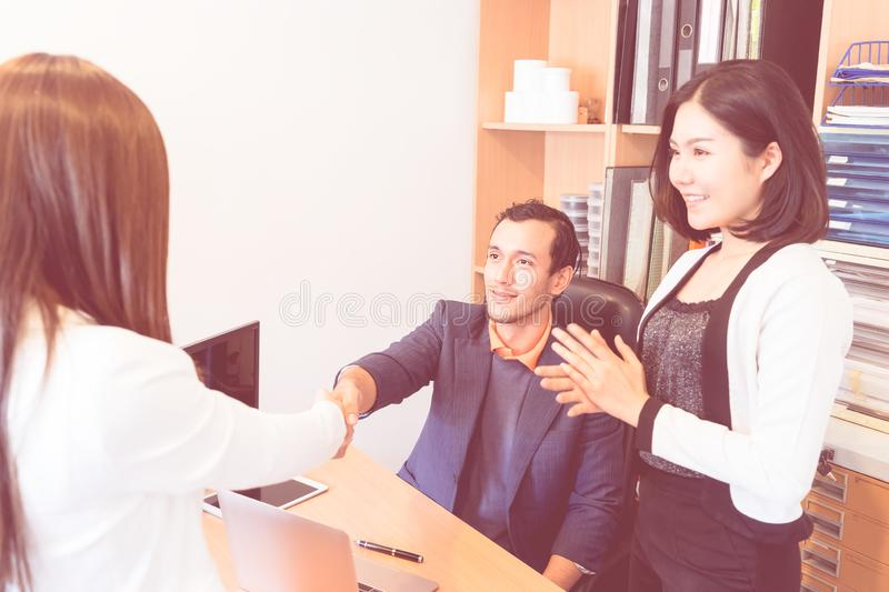 Business people with introduction handshake with partner royalty free stock image