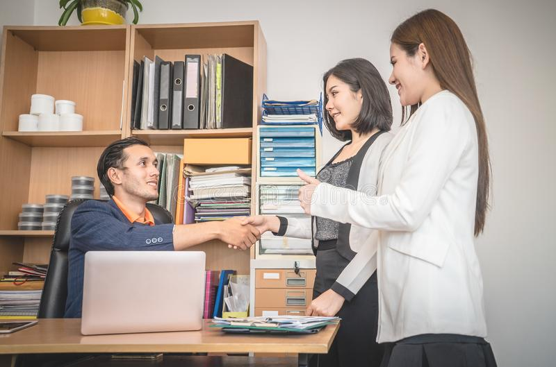Business people introduction handshake with partner royalty free stock photos
