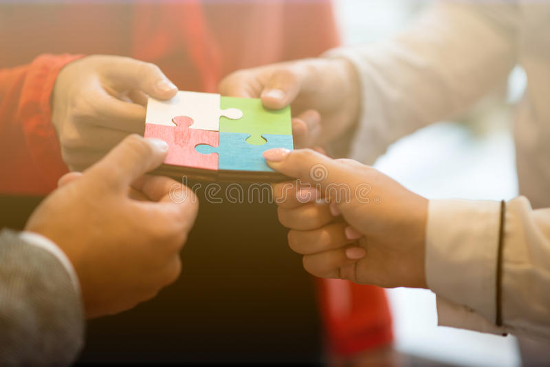 Business People Jigsaw Puzzle Collaboration Team Concept royalty free stock images
