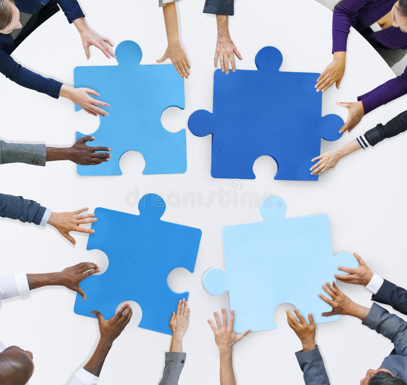 Business People And Jigsaw Puzzle Pieces Stock Image