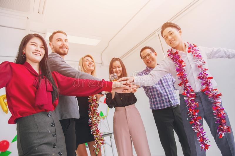 Business people join hand together in office party stock photo