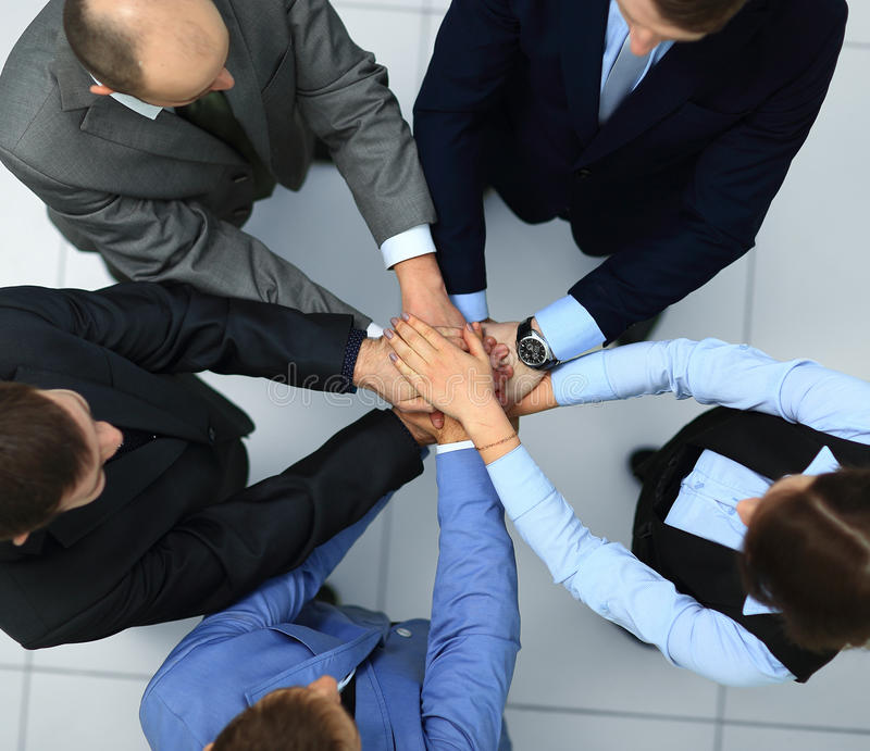 Business people joining stock images