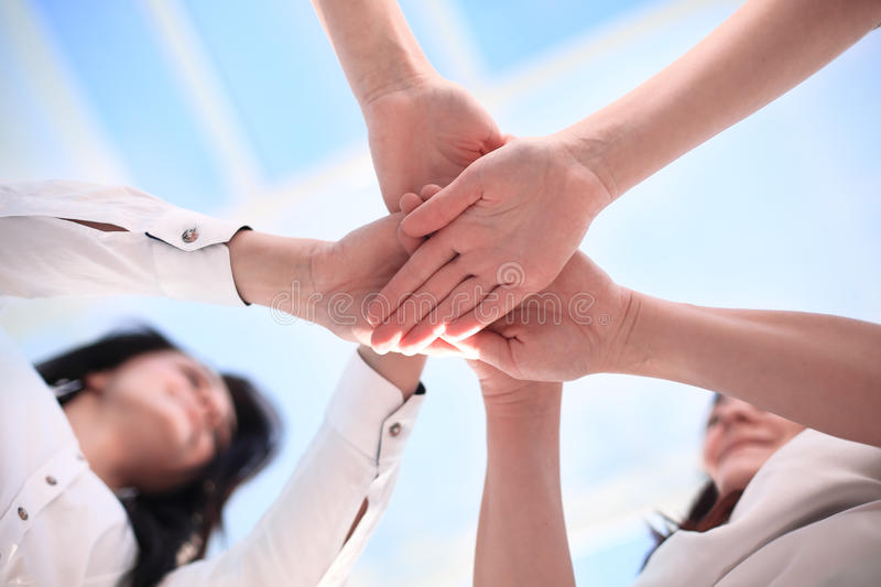 business people joining hands. stock photography