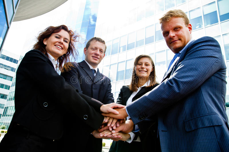 Business people joining hands stock photos