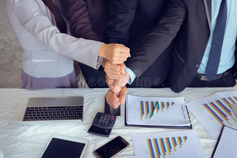 Business people are joining hands stack, Unity and business team stock images