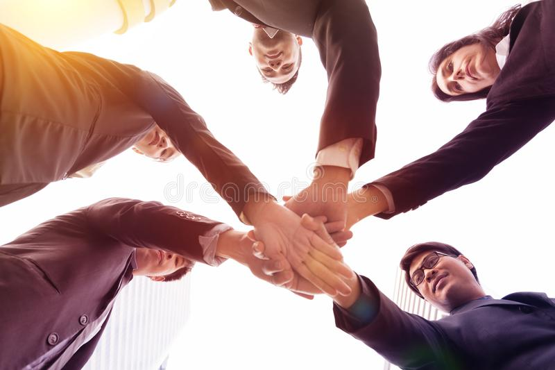 Business people joining hands. stock images