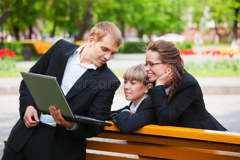 Download Young Business People Using Laptop In City Park Stock Image - Image: 20084923
