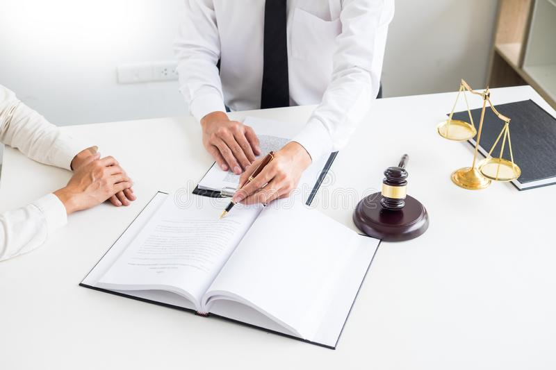 Business people and lawyers discussing contract papers sitting a royalty free stock photos