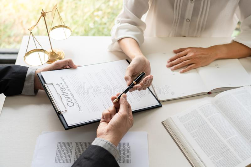 Business people and lawyers discussing contract papers sitting at the table. Concepts of law, advice, legal services, legal and royalty free stock image