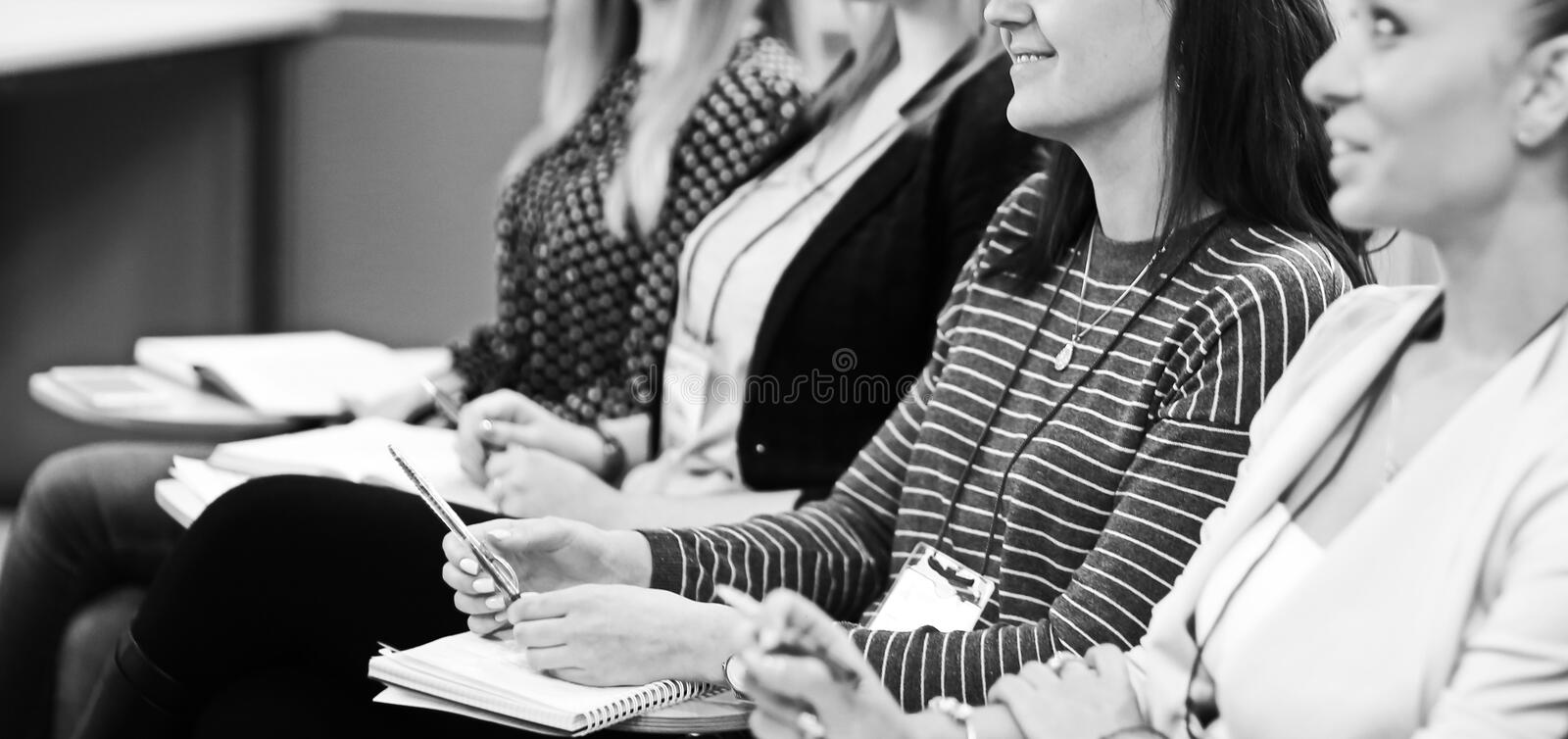 Business people listening to a lecture at a business seminar stock photos