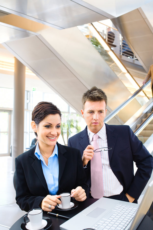 Business people in lobby stock photos
