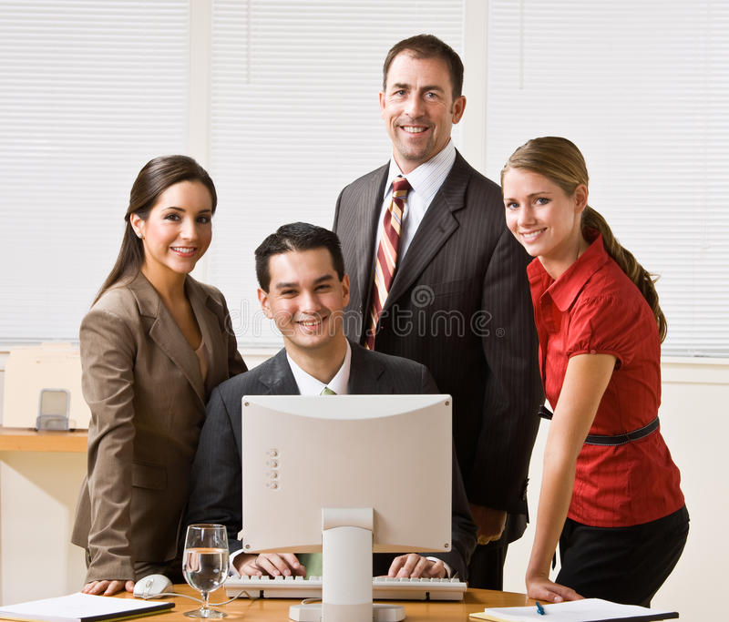 Business people looking at computer royalty free stock photos