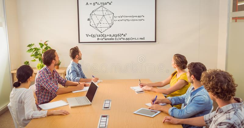 Business people looking at diagram on screen in conference room. Digital composite of Business people looking at diagram on screen in conference room royalty free stock photos