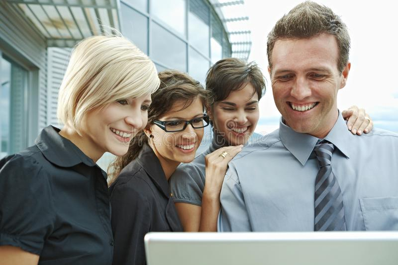 Download Business People Looking At Laptop Stock Photo - Image: 13287548
