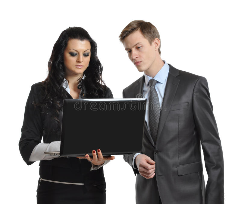 Business people looking at laptop stock photo