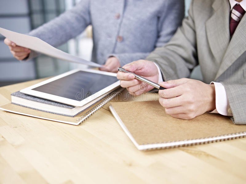Download Business People Looking At Report Stock Photo - Image: 38521316