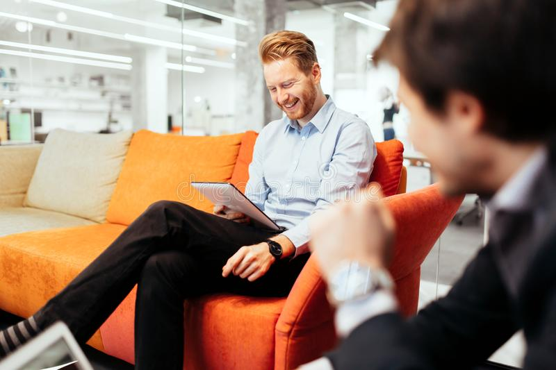 Business people looking at their devices. And working royalty free stock photography