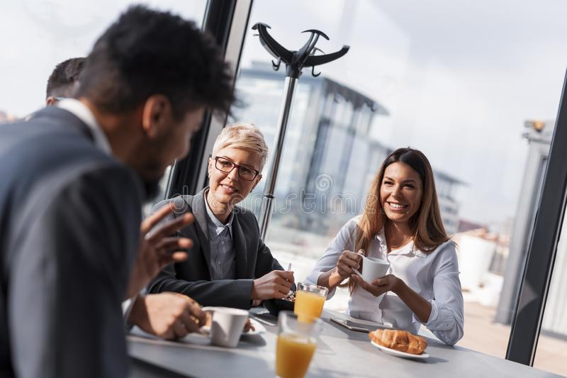 Business people on a lunch break. Group of business people on a lunch break in company`s restaurant stock images
