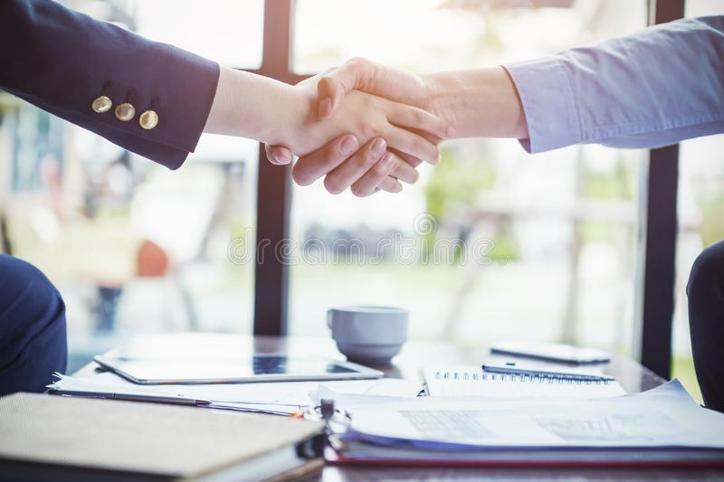 Business people make a deal with handshake at office or cafe. Success business concept. royalty free stock photography