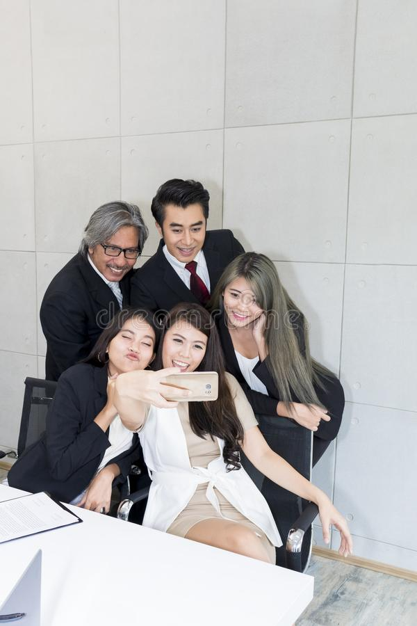 Business people make selfie photo and smiling. stock photography