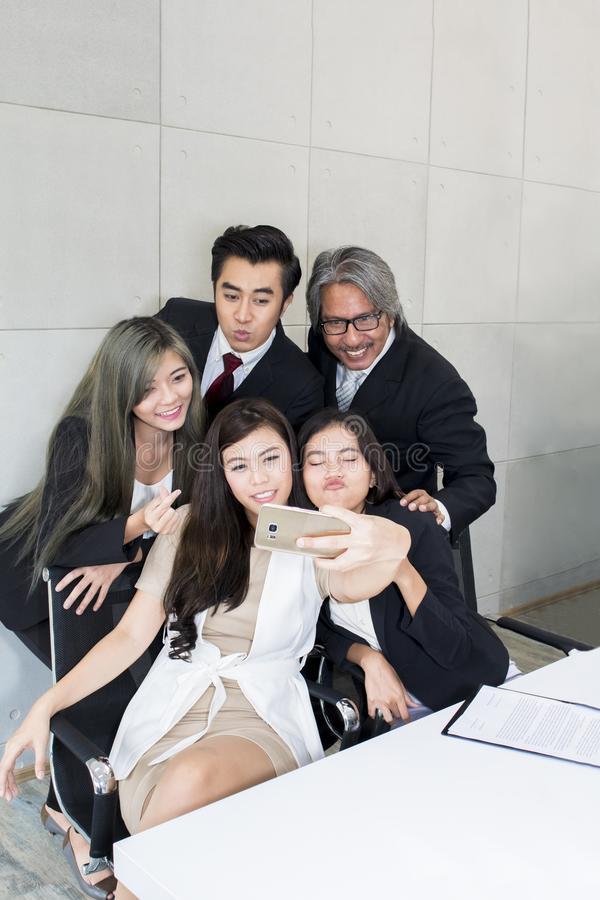 Business people make selfie photo and smiling. royalty free stock image