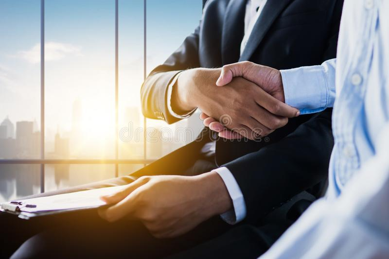 Business people making handshake, successful negotiation and agreement of partnership communication. Commerce, white, businesswoman, staff, adult, formal stock image