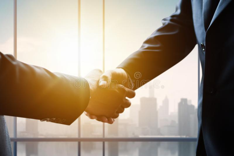 Business people making handshake, successful negotiation and agreement of partnership communication. Commerce, white, businesswoman, staff, adult, formal royalty free stock photos