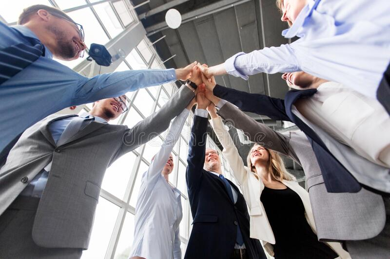 Business people making high five at office royalty free stock photo