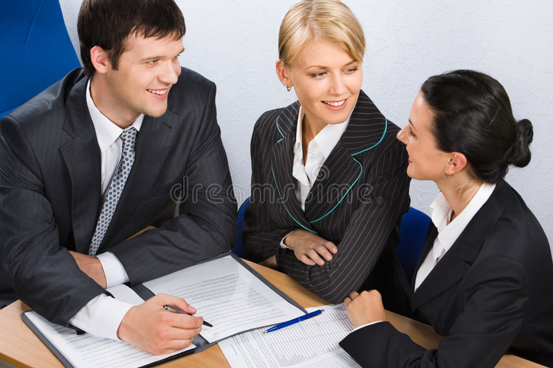Business people at a meeting stock photos