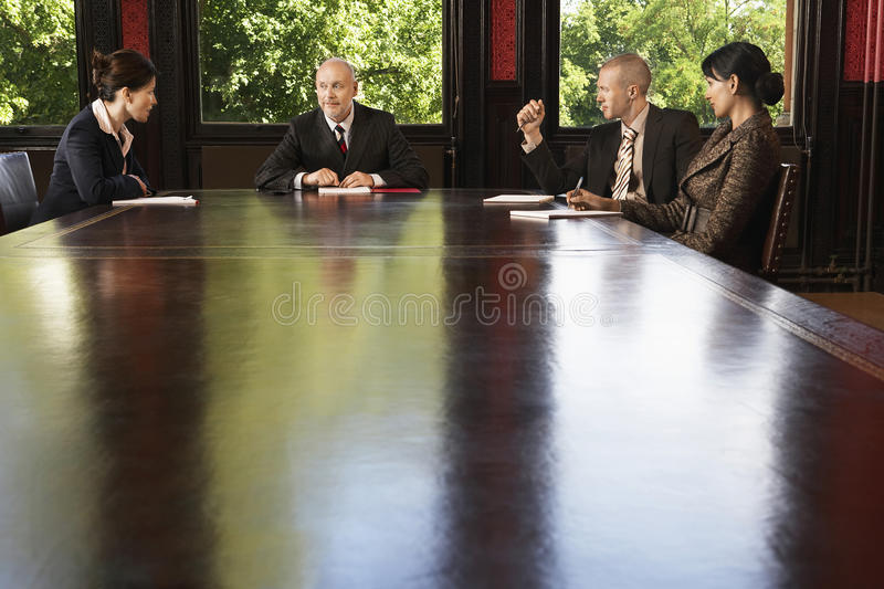 Business People Meeting Around Boardroom Table stock photos