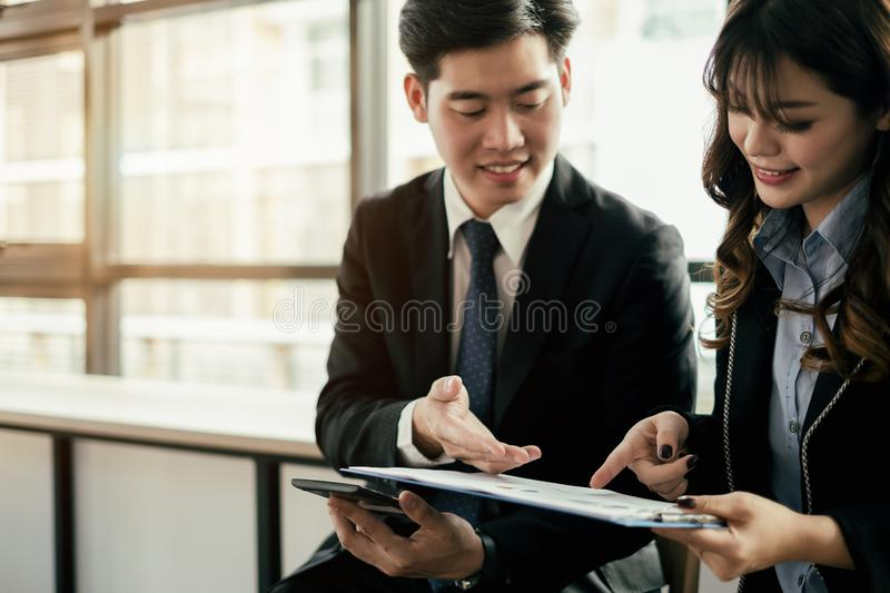 Business people meeting brainstorming and discussing project with laptop and mobile phone, teamwork concept royalty free stock images