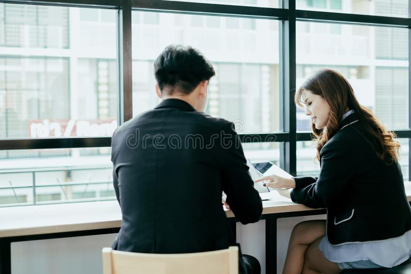 Business people meeting brainstorming and discussing project with laptop and mobile phone, teamwork concept stock photos