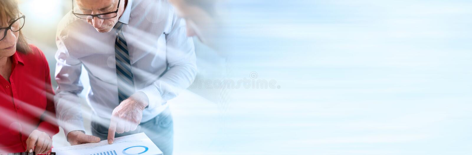 Business people in meeting discussing about financial results, light effect; panoramic banner royalty free stock photos