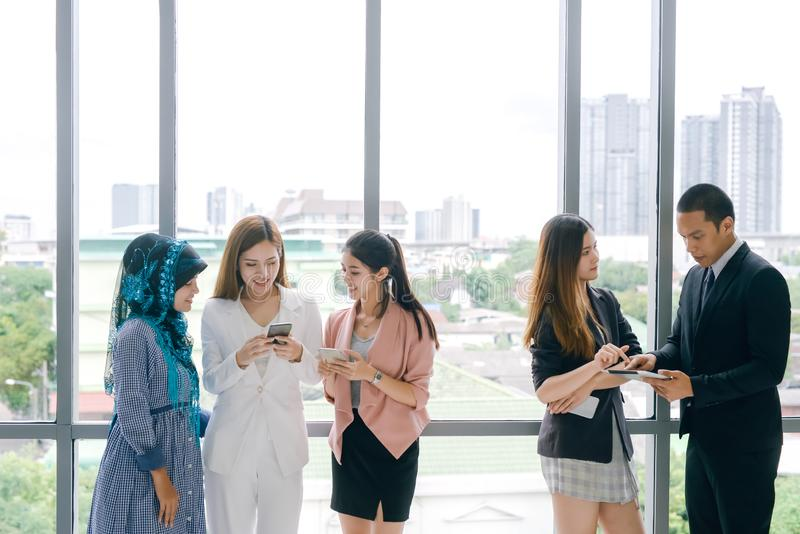 Business People Meeting Discussion Working and talking in office. Young people using smart phones at workplace. stock photos