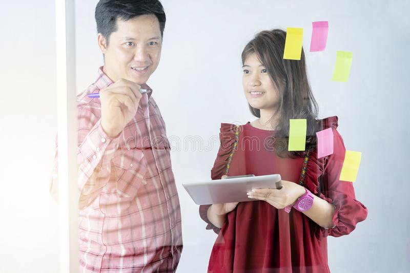 Business people meeting at office and use post it notes to share idea stock photo