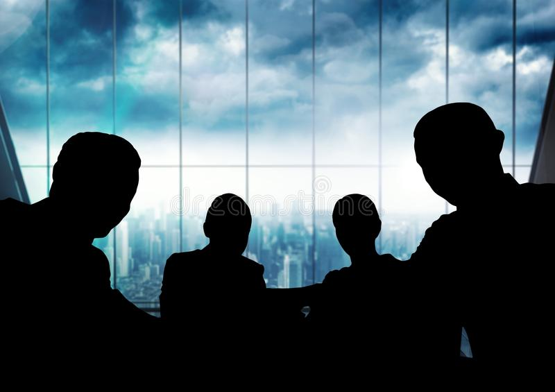 Business people at a meeting silhouettes against building stock image