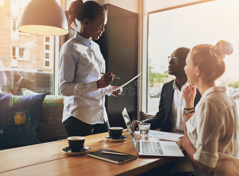 Business people at a meeting, small group. Multi ethnic business, entrepreneur concept stock image
