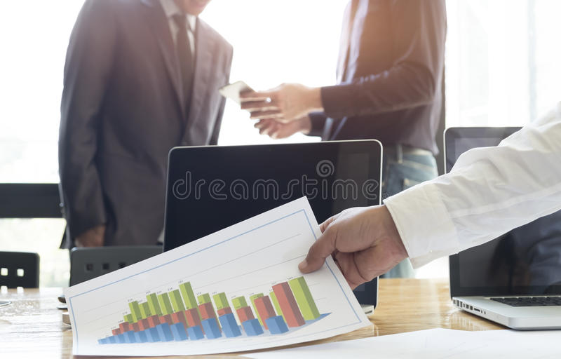 Business people meeting to discuss the situation on the market. royalty free stock image